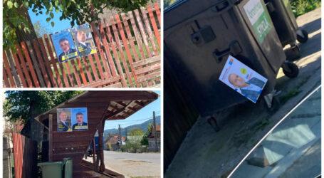 """USR face """"circ"""" pentru afișele lipite de PNȚCD pe stâlp, dar nu vede afișele lor de pe coșul de gunoi și ale PNL de pe gardul bisericii"""