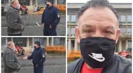 VIDEO. Un om de afaceri din Zalău care protesta în ploaie, AMENDAT de Jandarmerie